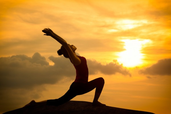 What is the purpose of sun salutations in Yoga?